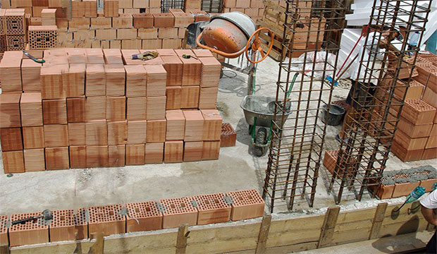 Construction cost estimating blog how to lay brick and for Brick home construction costs